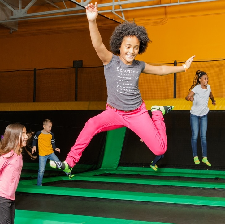 Girl Jumping and Smiling At Rockin Jump